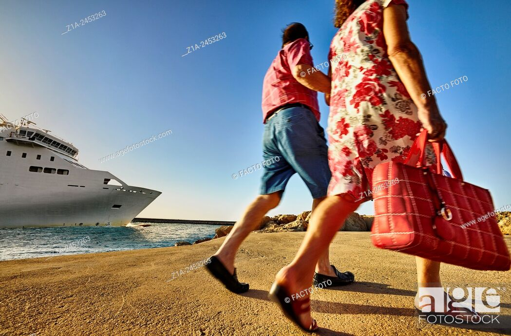 Stock Photo: People walking by the seafront promenade at the harbour. Denia. Alicante. Valencia Community. Spain.
