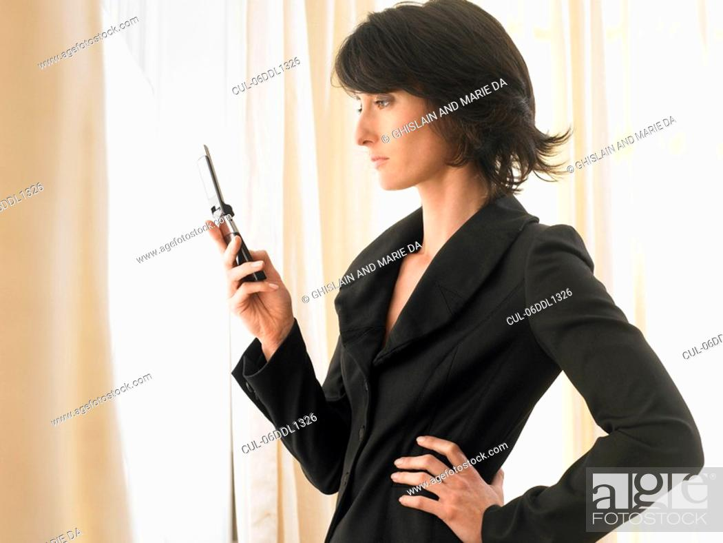 Stock Photo: Woman with cell phone.