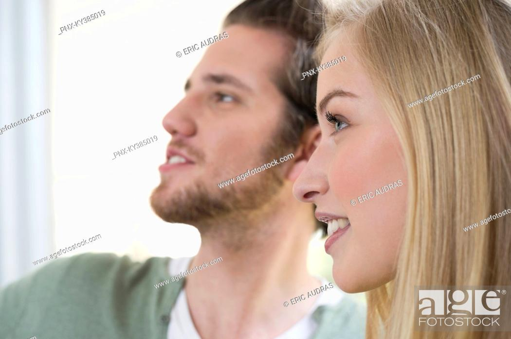 Stock Photo: Close-up of a woman with a man beside her.