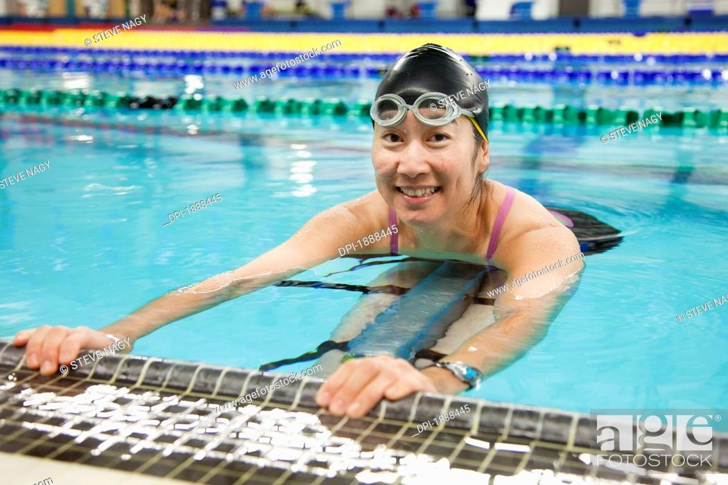 Stock Photo: a paraplegic woman swims in a pool, edmonton, alberta, canada.