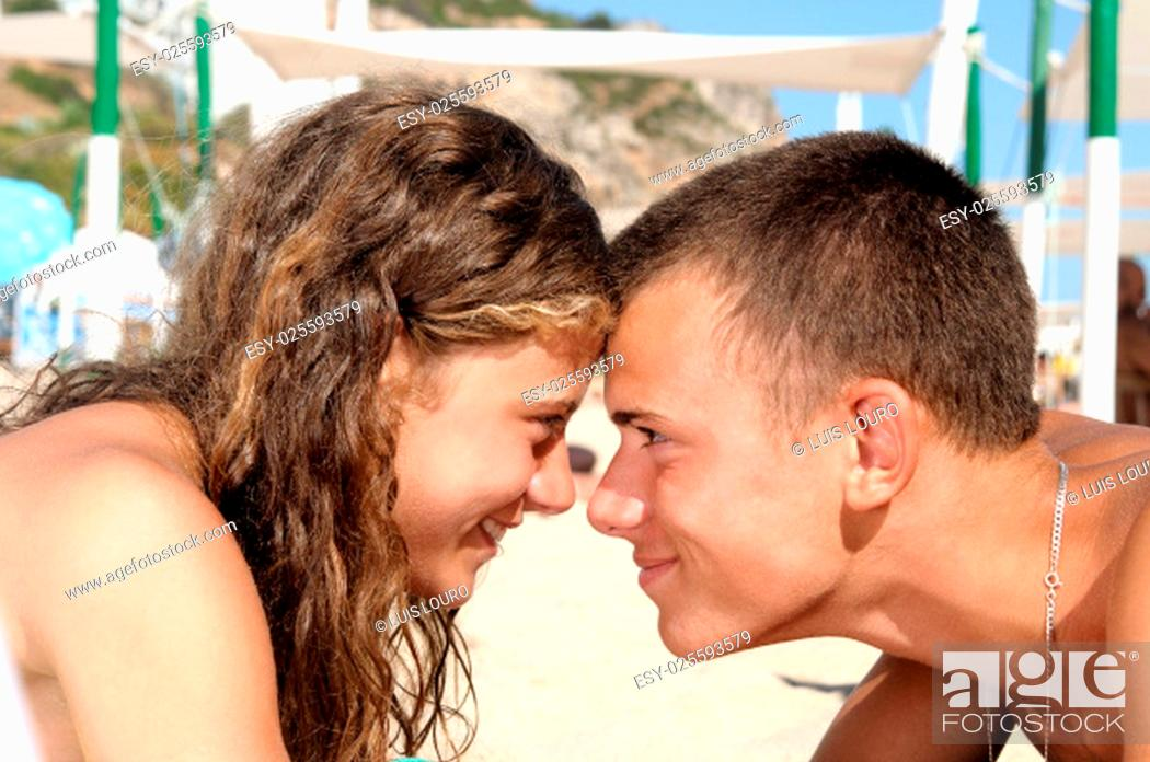 Stock Photo: Young teenagres couple together in the beach.