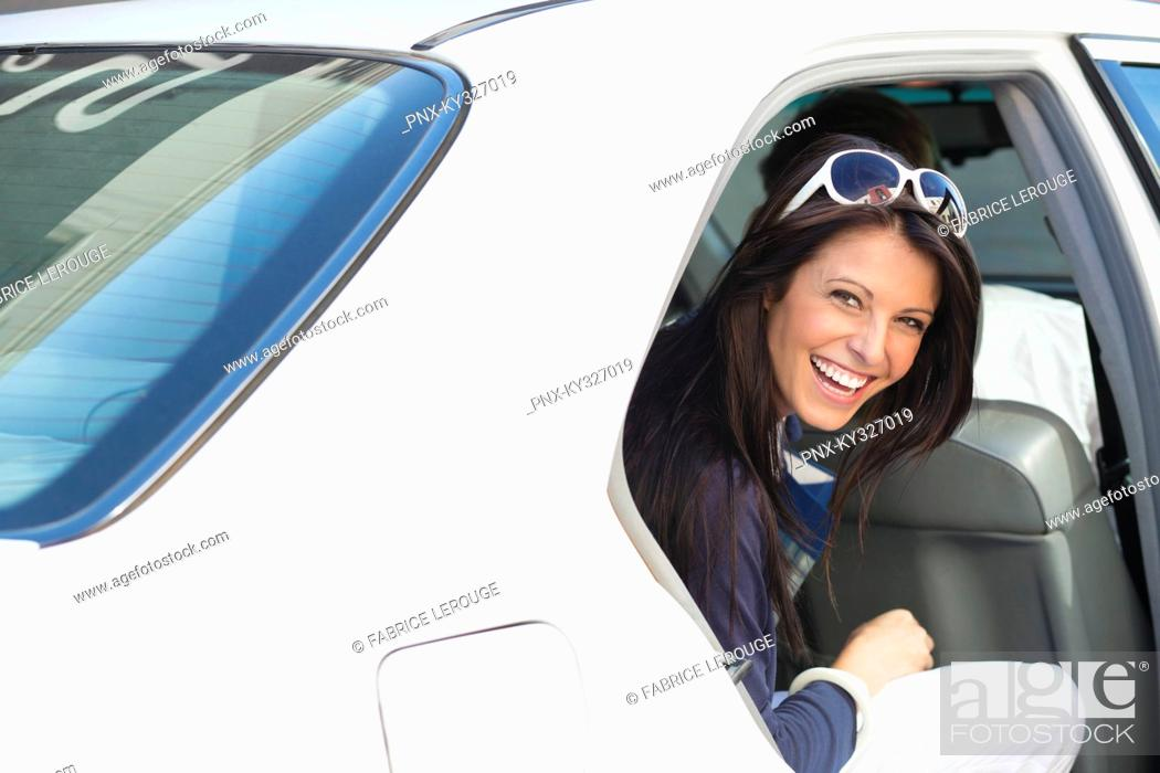 Stock Photo: Portrait of a beautiful woman sitting in a car.