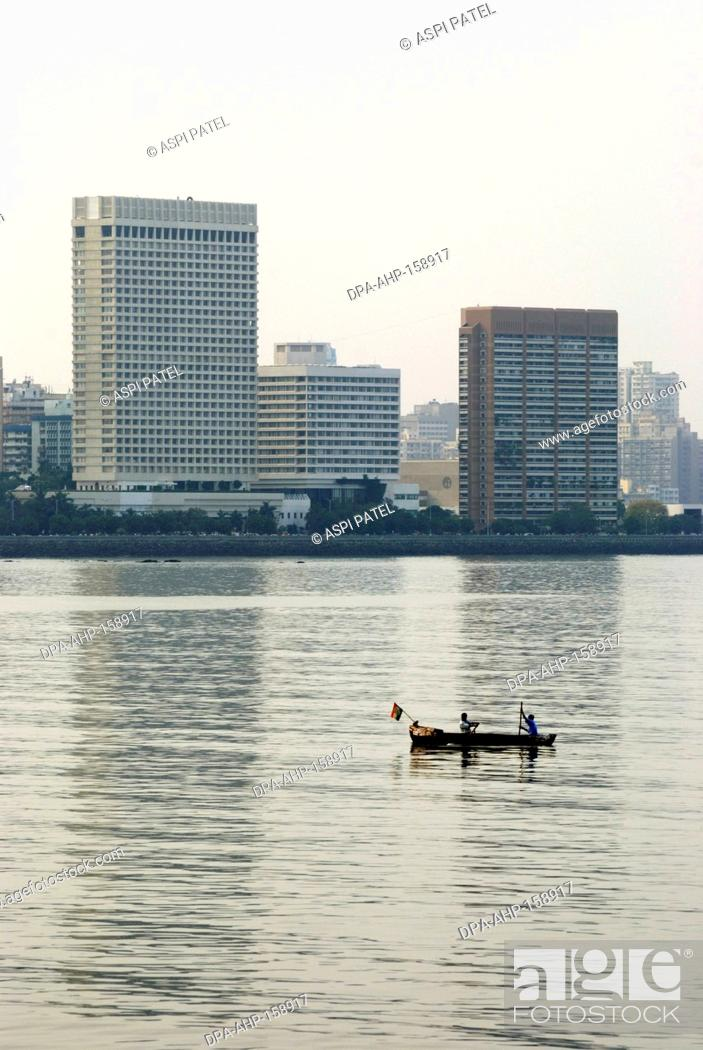 Stock Photo Oberoi And Hilton Hotels At Sea Nariman Point With Small Fishing Boat