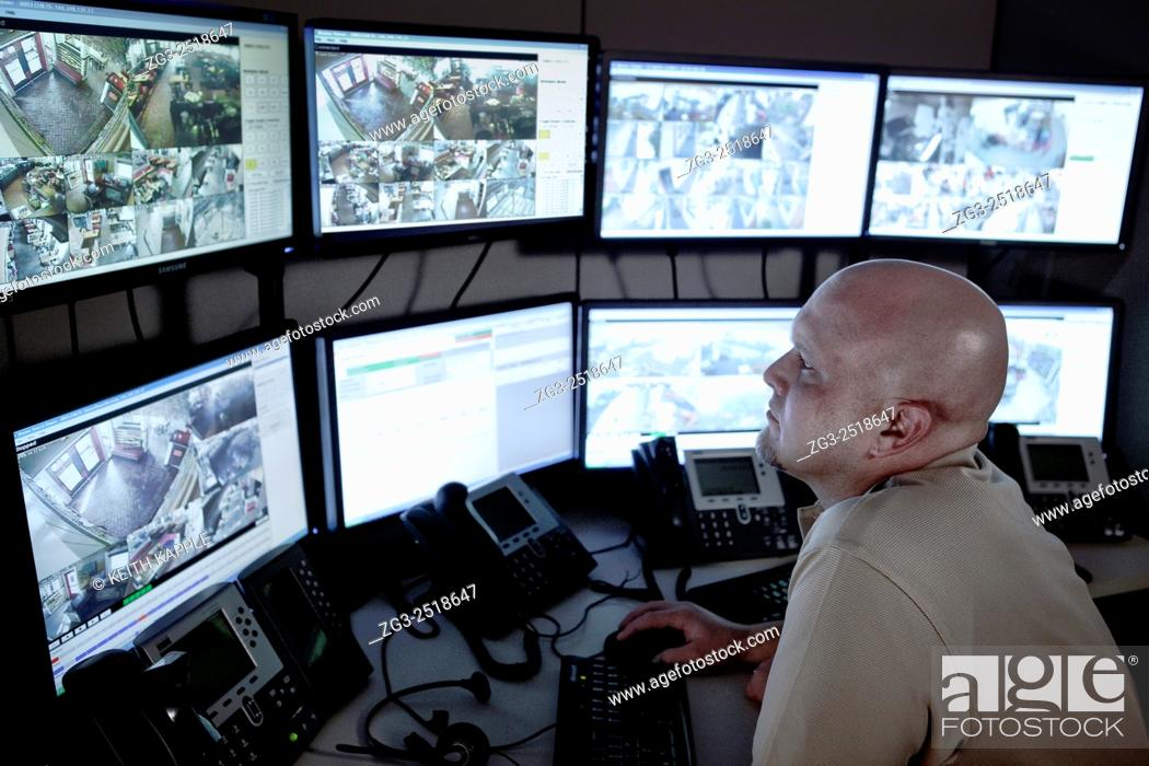 Stock Photo: Video surveillance, control room with monitor wall.