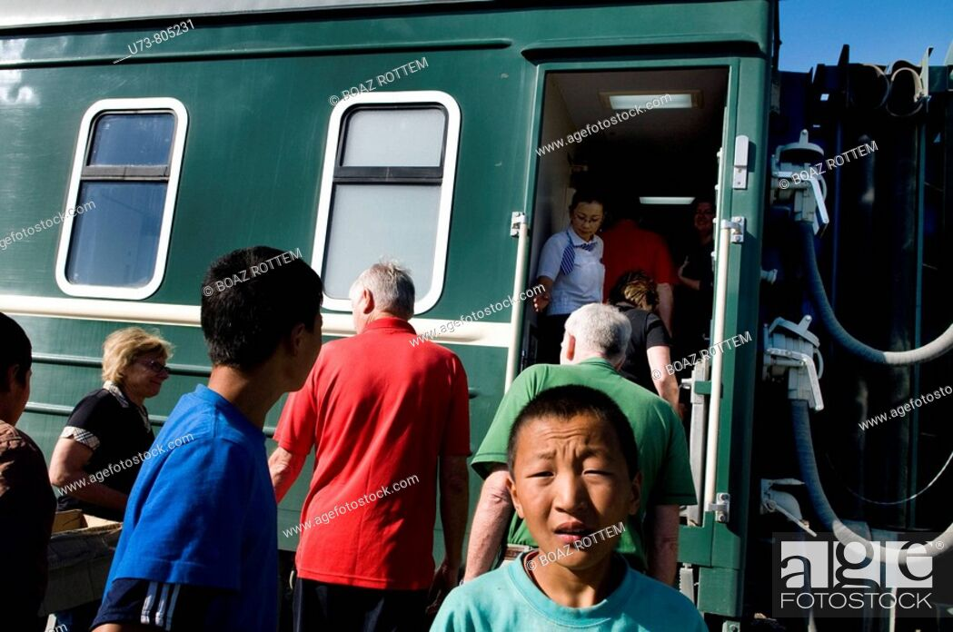 Stock Photo: Mongolian tran stops at a small station in Mongolia.