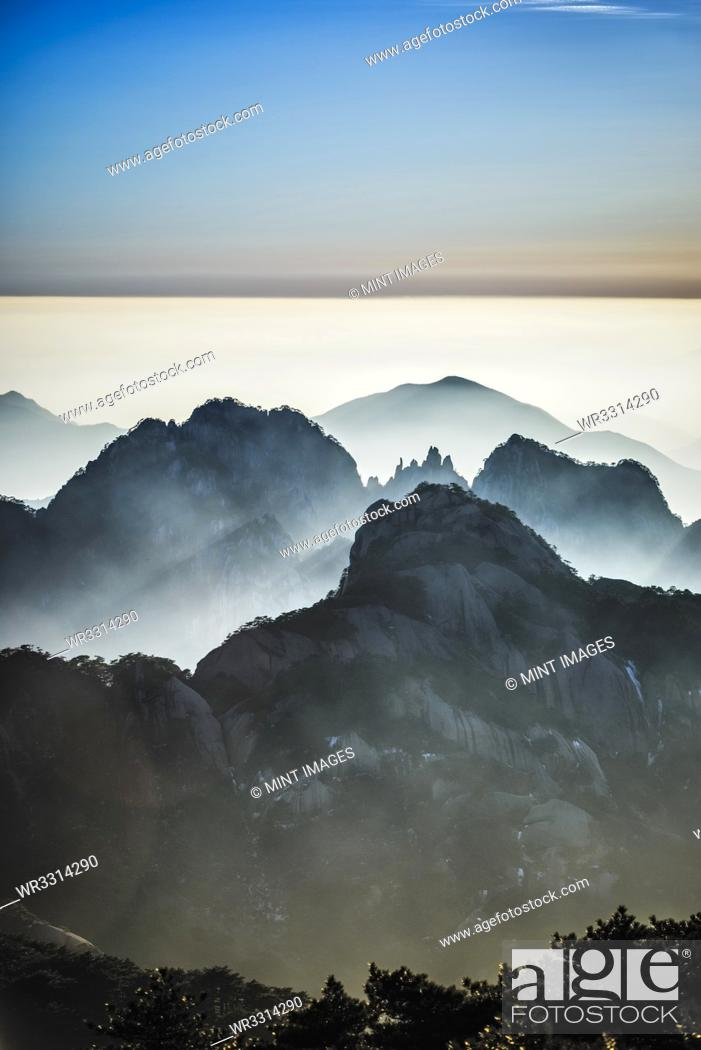 Stock Photo: Fog rolling over rocky mountains, Huangshan, Anhui, China,.