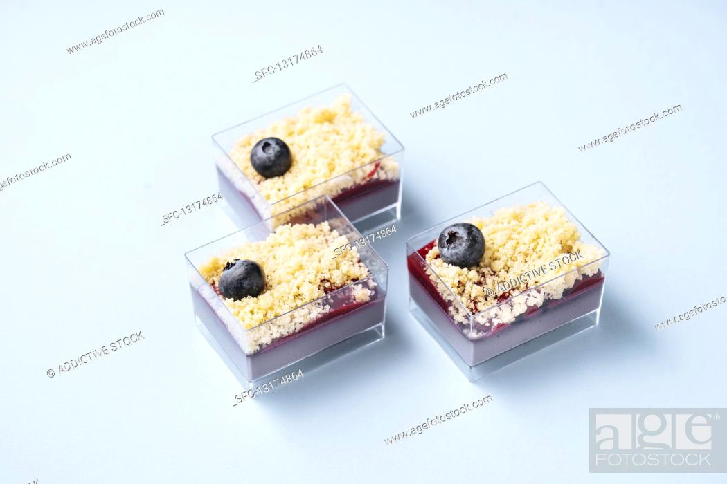 Photo de stock: Glass containers with blueberry cakes.