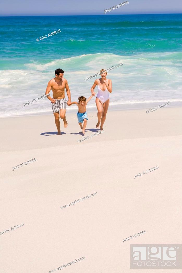 Stock Photo: Family running on the beach.