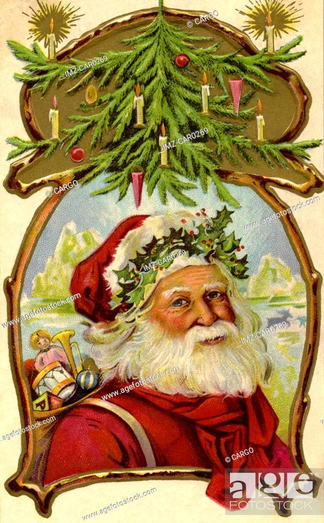Stock Photo: Vintage Christmas postcard of Santa Claus carrying a sack of toys underneath a Christmas tree.