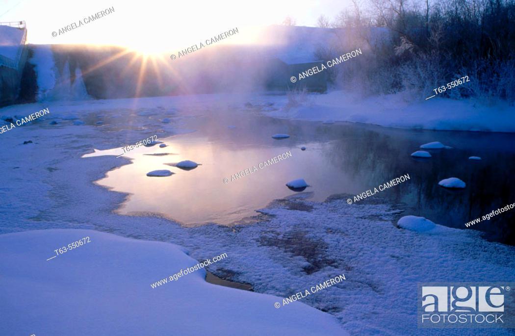 Stock Photo: Sun setting over frozen lake. Manitoba, Canada.