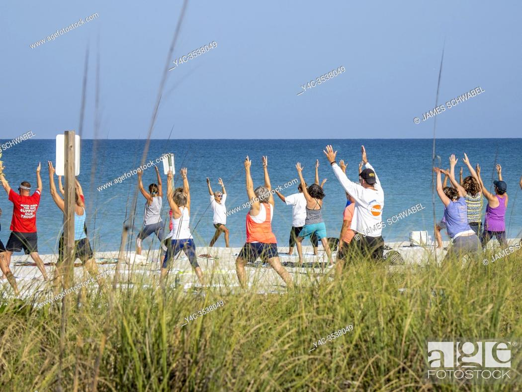 Stock Photo: Morning Yoga on Englewood Beach on Manasota Key on the Gulf of Mexico in Englewood FLorida in the United States.