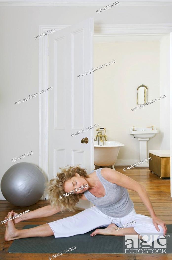 Stock Photo: Woman stretching.