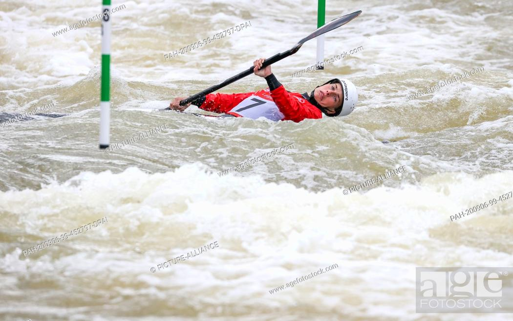 Stock Photo: 06 September 2020, Saxony, Markkleeberg: Canoe/Slalom: German championship. Cindy Pöschel from Leipzig dives under a gate in the final Women's Kayak.