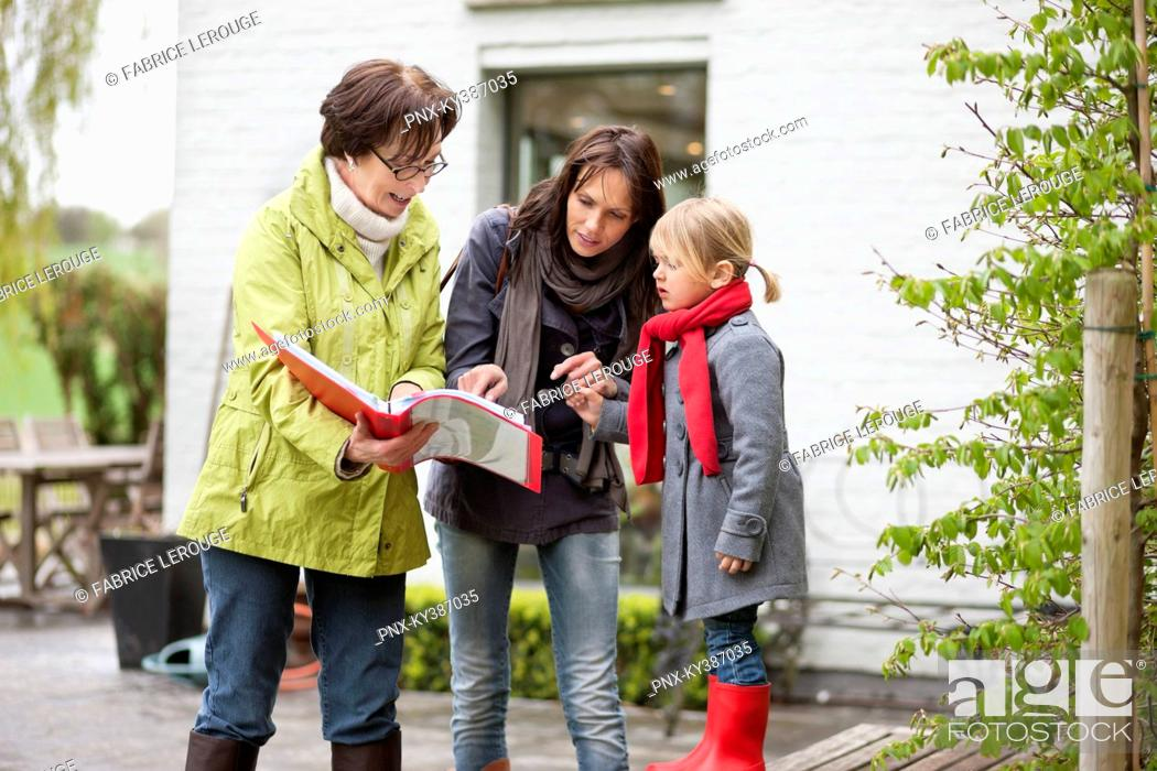 Stock Photo: Real estate agent showing woman a property.