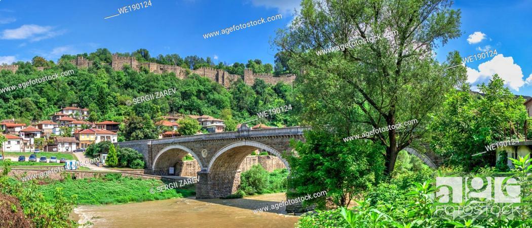 Stock Photo: Bridge over the Yantra River near Veliko Tarnovo Fortress, Bulgaria. Hi res panoramic view on a sunny summer day.