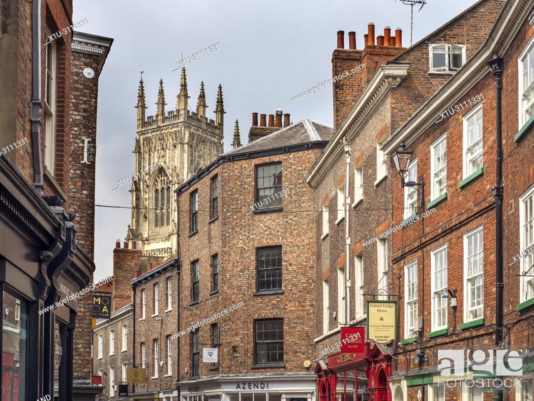 Stock Photo: Tower of York Minster visible from Petergate City of York Yorkshire England.