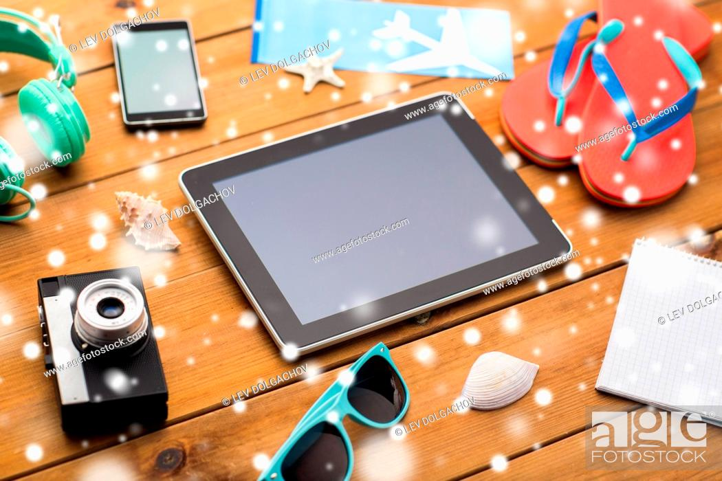 Stock Photo: vacation, tourism, technology and objects concept - close up of tablet pc computer and travel stuff.
