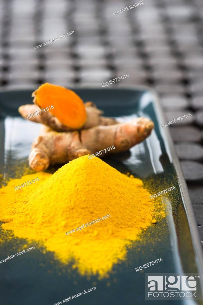Stock Photo: Tumeric powder and fresh tumeric.