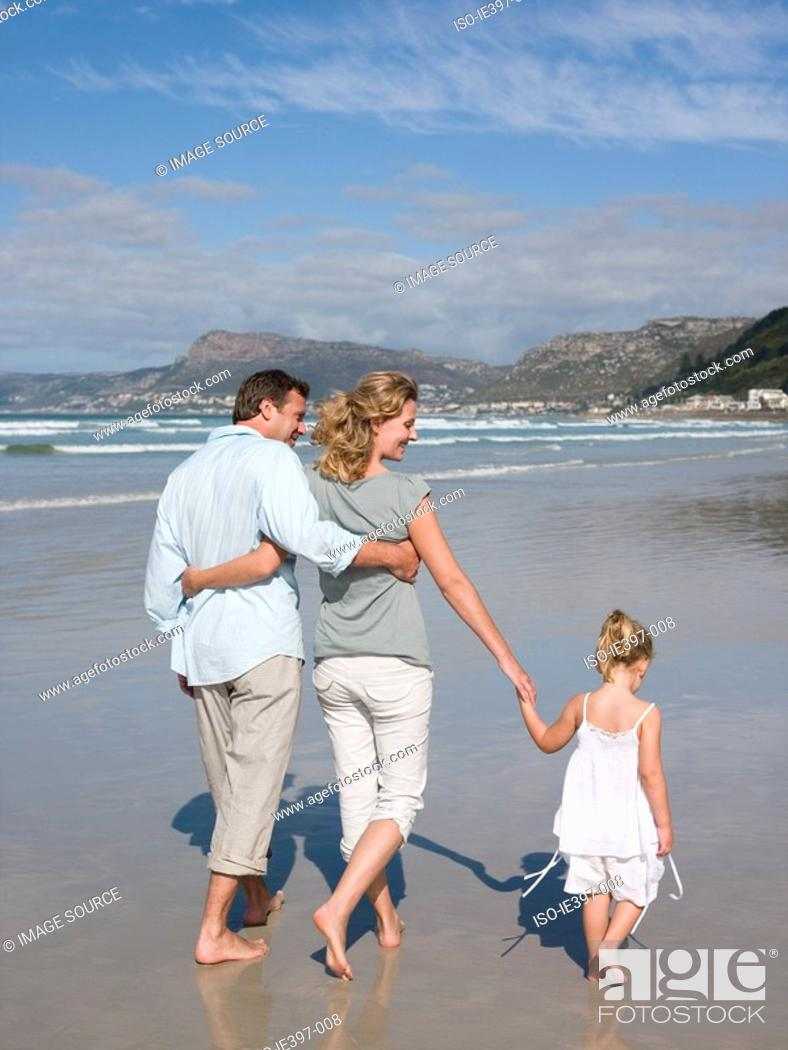 Stock Photo: Family walking by the sea.