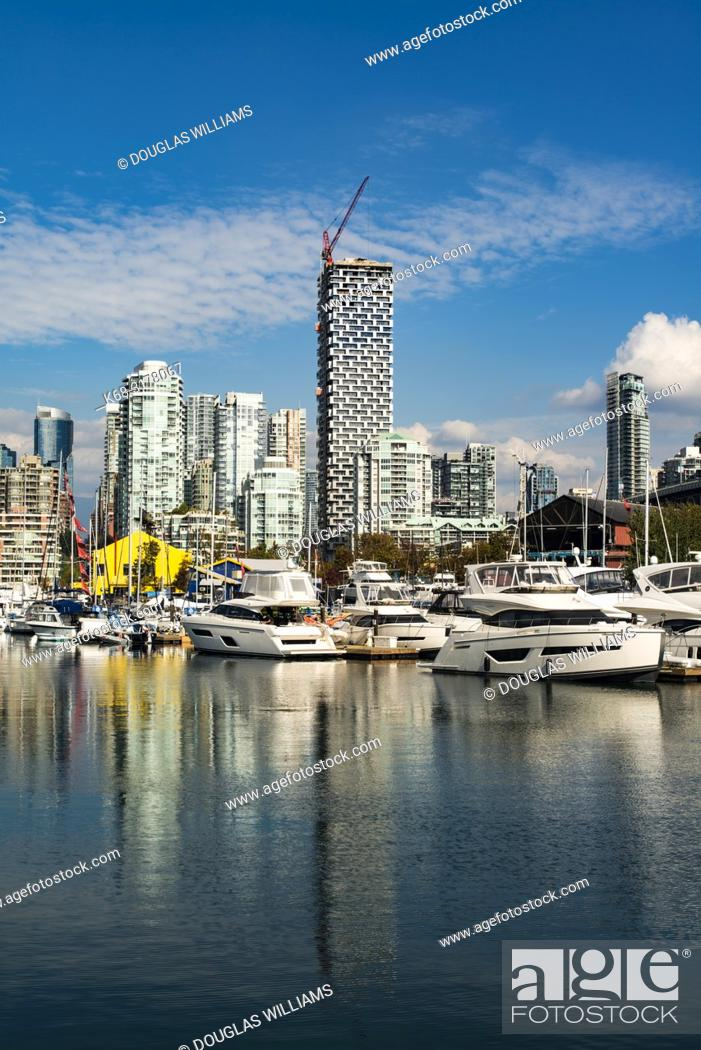 Stock Photo: downtown apartment buildings, including Vancouver House, centre and the marina at Granville Island on False Creek Vancouver, BC, Canada.