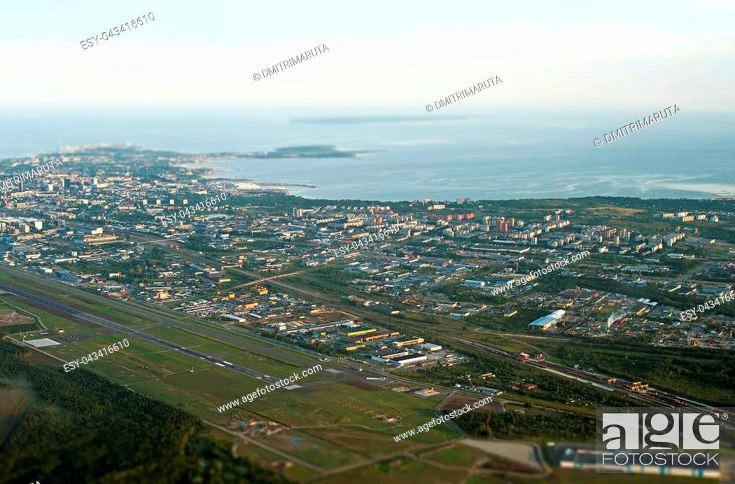 Stock Photo: View from the plane to Tallinn airport and Lasnamae district.