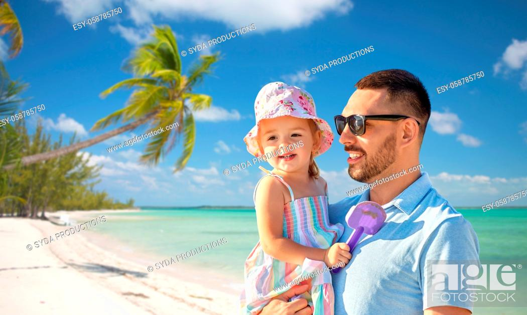 Stock Photo: happy father with little daughter on beach.
