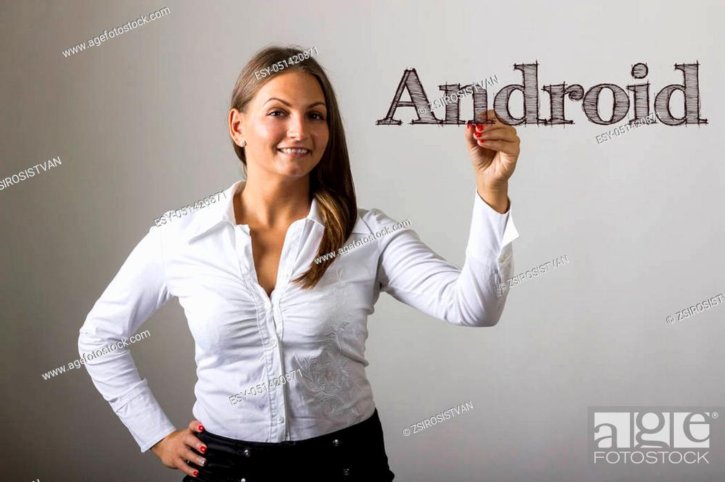 Stock Photo: Android - Beautiful girl writing on transparent surface - horizontal image.