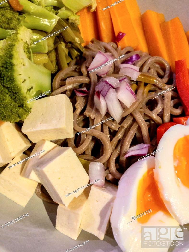 Stock Photo: Japanese soba noodles with tofu, broccoli, carrots, onions, capsicum and boiled egg.
