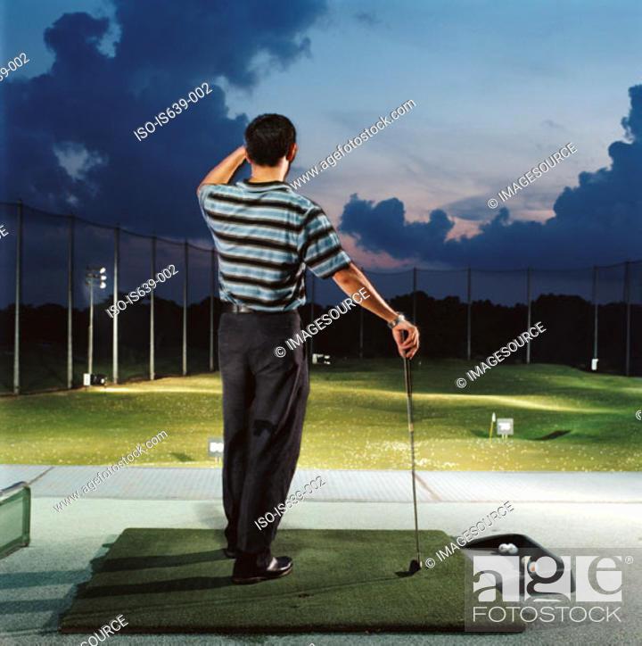 Stock Photo: Man practising on driving range.