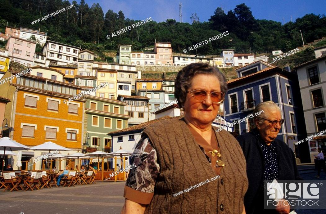 Stock Photo: Old women in Cudillero. Asturias. Transcantabrian train through the north of Spain.