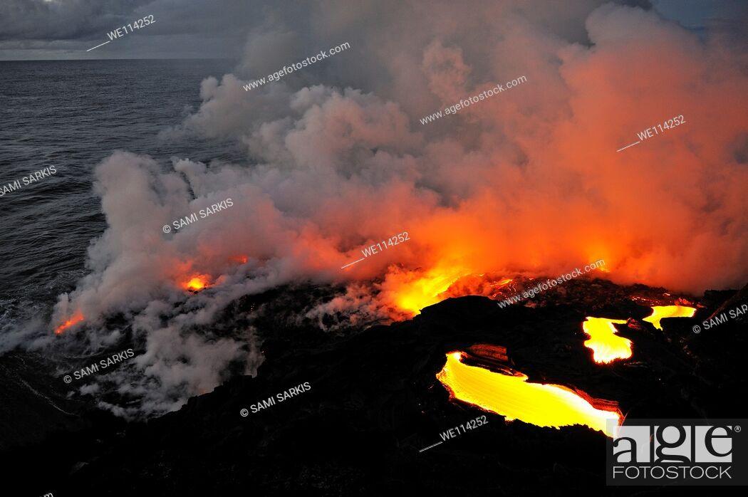 Stock Photo: Steam rising off lava flowing into ocean, Kilauea Volcano, Big Island, Hawaii Islands, Usa.