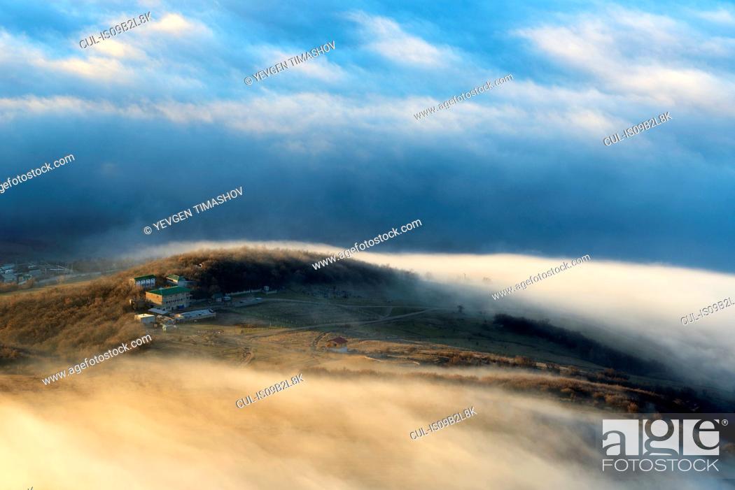Stock Photo: View of dispersing mountain mist from Luchistoye Village, South Demergi mountain, Crimea, Ukraine.