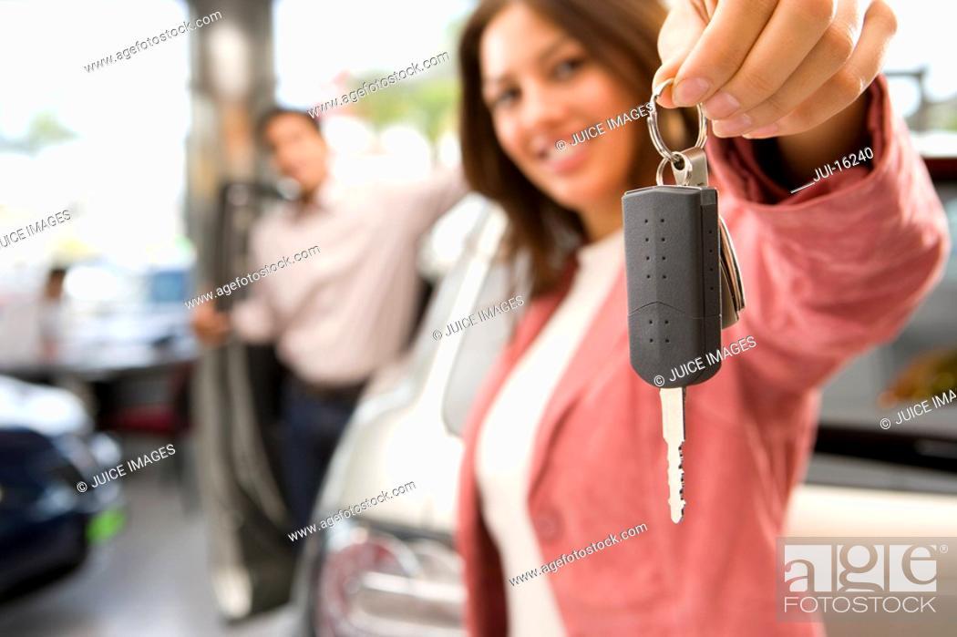 Stock Photo: Woman holding up new car keys.