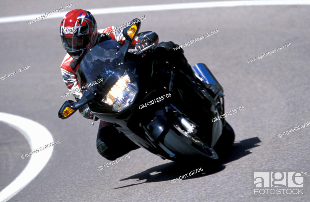 Stock Photo: Sports motor cycle, Sporttourer, Honda CBR 1100 XX Super Blackbird, black, model year 2003, driving, inclined position, Side position, from the front.