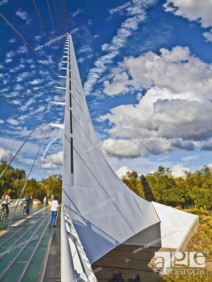 Stock Photo: Sundial Bridge in Redding, California. This 710 foot span crosses the Sacramento River, and forms a working sundial. The glass decked bridge is used only for.