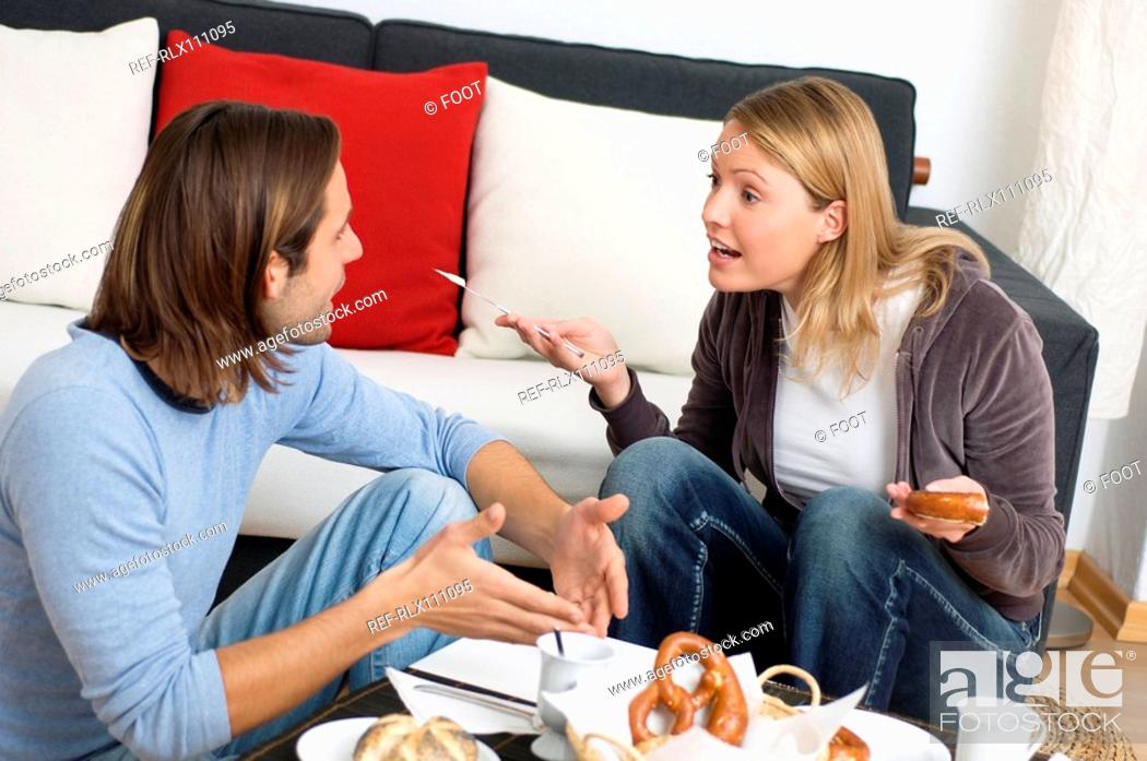 Stock Photo: Young couple arguing at breakfast table.
