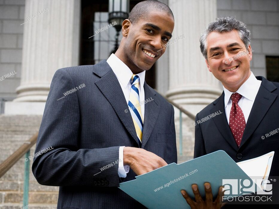 Stock Photo: Low angle view of two lawyers smiling.