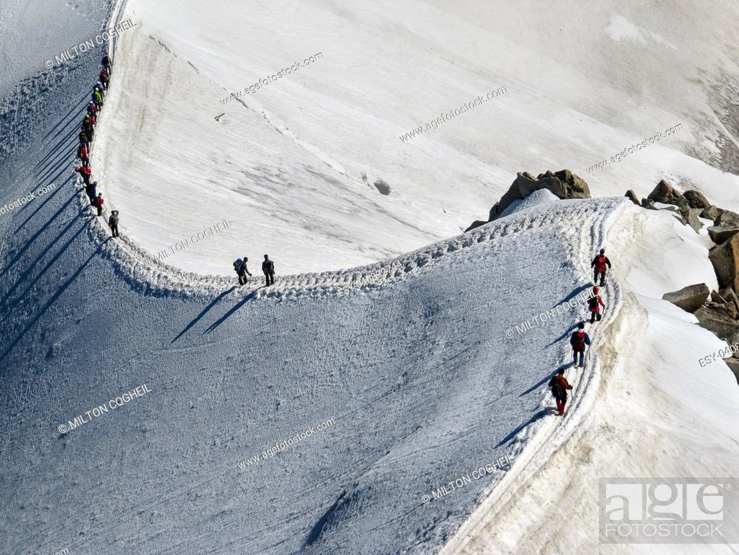Stock Photo: Trekkers on Aiguille Du Midi, in the french alps.