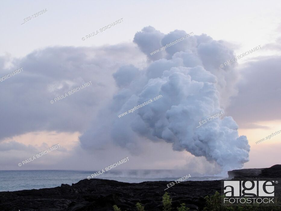 Stock Photo: Billowing steam rising from 2000-degree lava flowing into the sea, from the Pu'u O'o vent of Kilauea volcano, Hawaii Volcanoes National Park, Hawaii, USA.