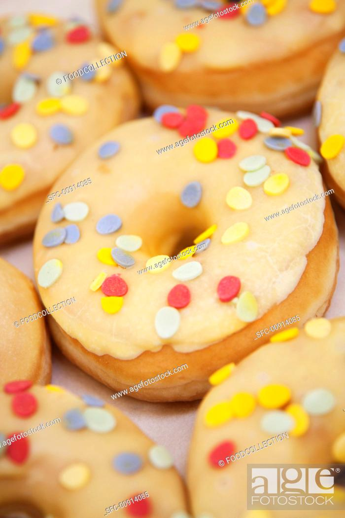 Stock Photo: Iced donuts with confetti sprinkles.