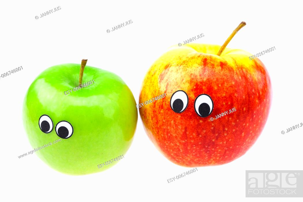 Imagen: apples with eyes and faces isolated on white.