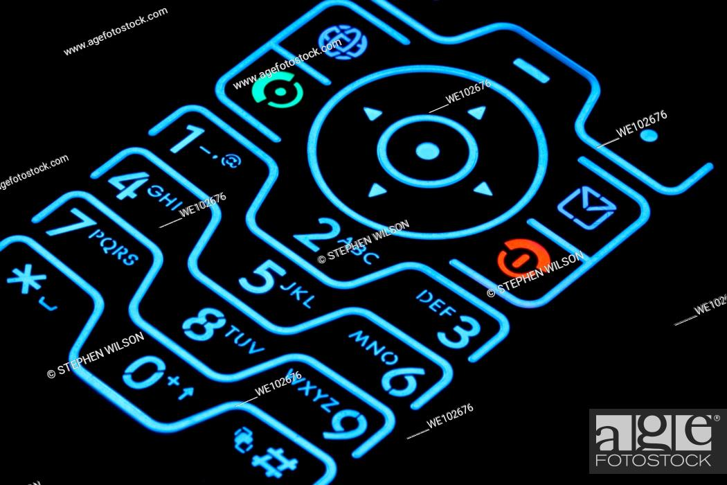 Stock Photo: Cellphone keypad illuminated.