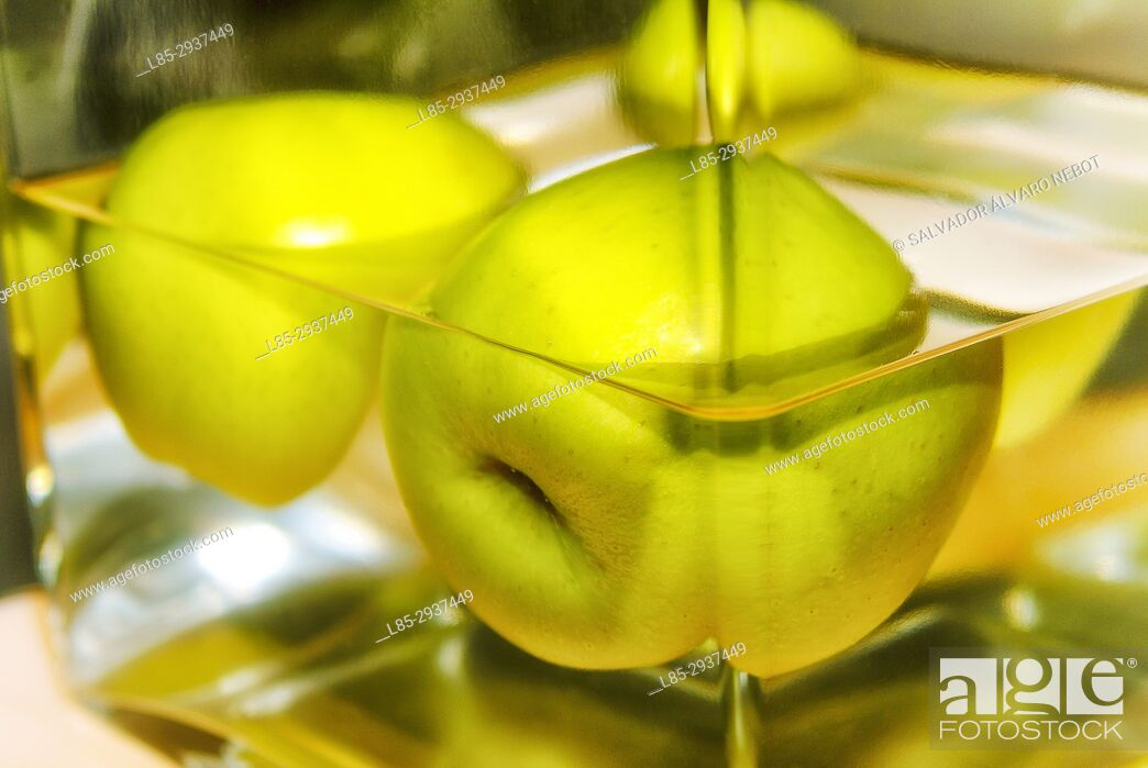 Stock Photo: Half-submerged apples in glass bowl.