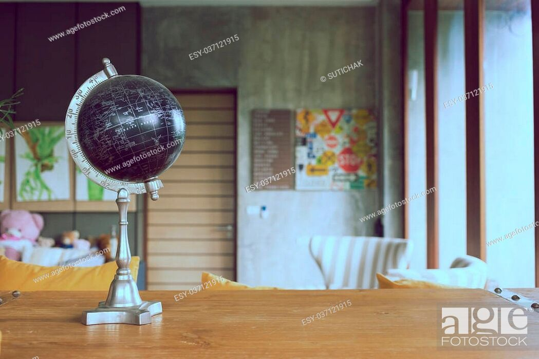 Stock Photo: model of black world decorated in living room with furniture background.