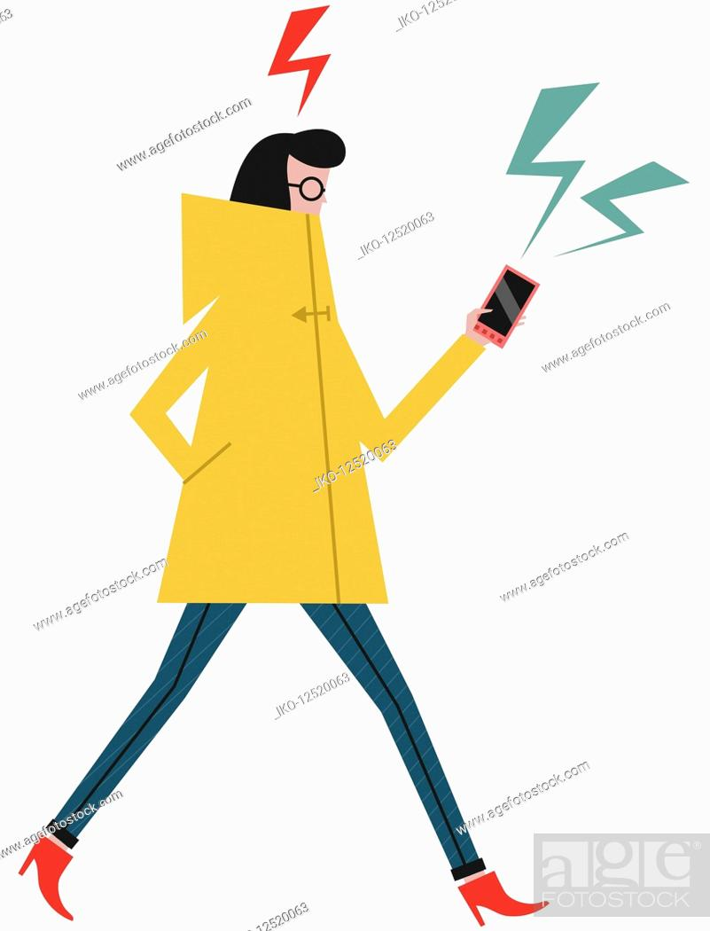 Stock Photo: Woman walking and concentrating on smart phone.
