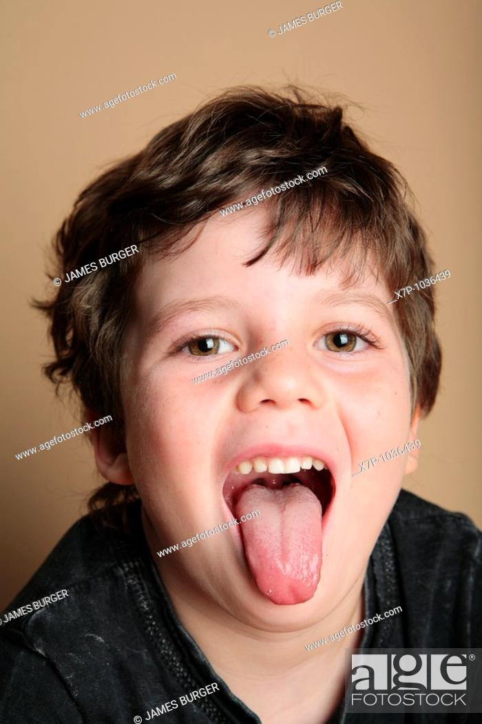 Stock Photo: Young boy making faces.