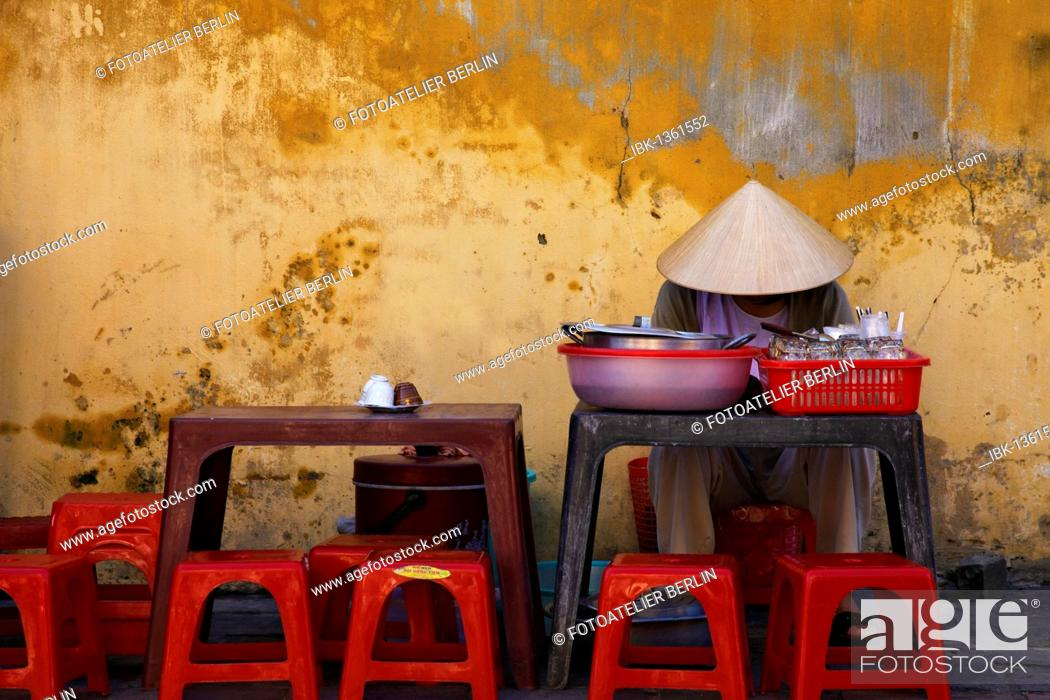 Stock Photo: Vietnamese woman waiting for customers at her streetside stall, Hoi An, Vietnam, Southeast Asia.