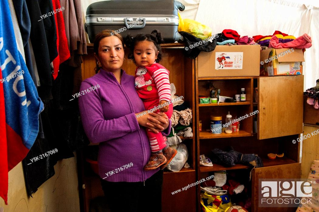 Stock Photo: Sofia, Bulgaria. Female Syrian refugee and her one year old daughter, living in refugee camp Vrajdebna.