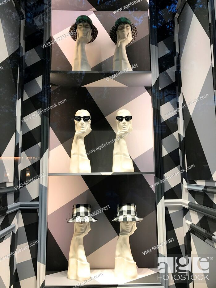 Stock Photo: Composition with mannequins in a shop window. Madrid, Spain.