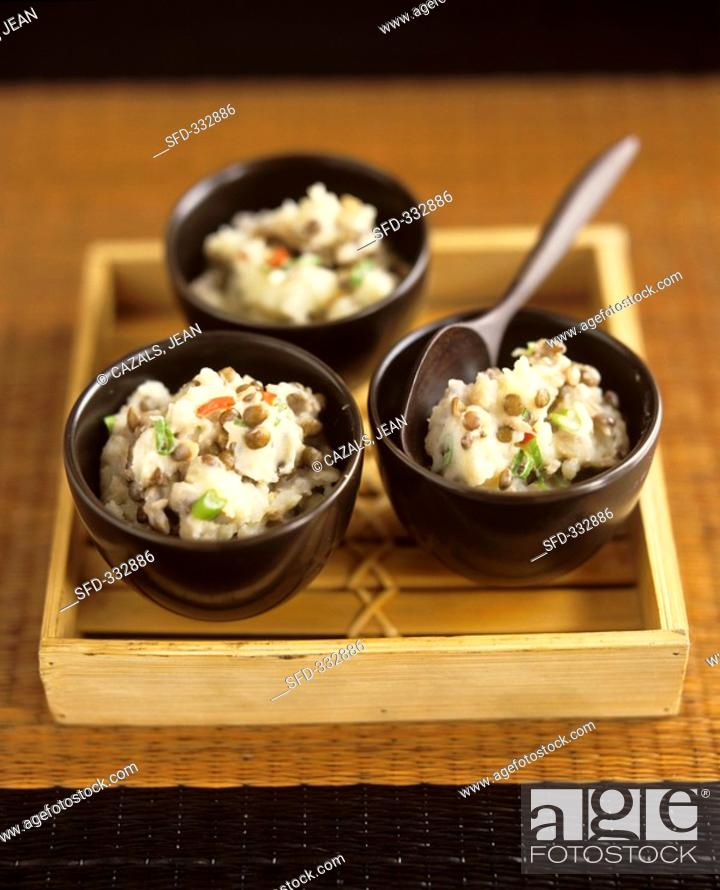 Stock Photo: Three small bowls of mashed potato with lentils.